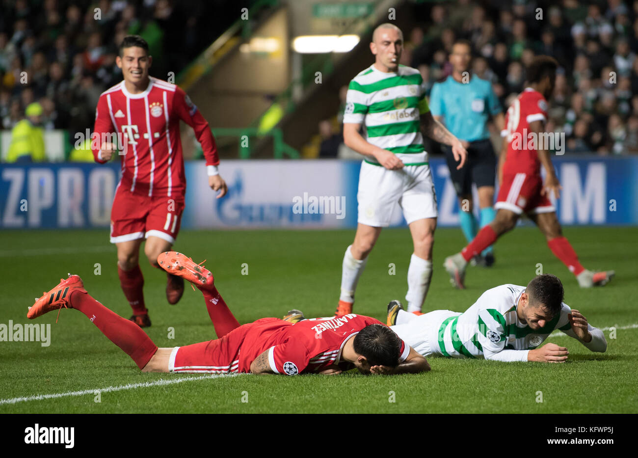Glasgow, UK. 31st Oct, 2017. Javi Martinez (L) of Bayern and Glasgow's Nir Bitton lie on the ground injured - Stock Image