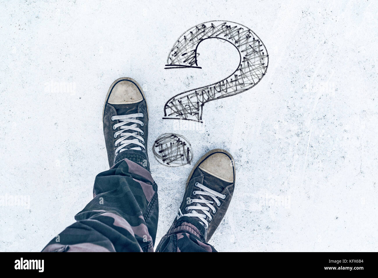 Question mark on the road and sneakers, wondering and asking questions - Stock Image