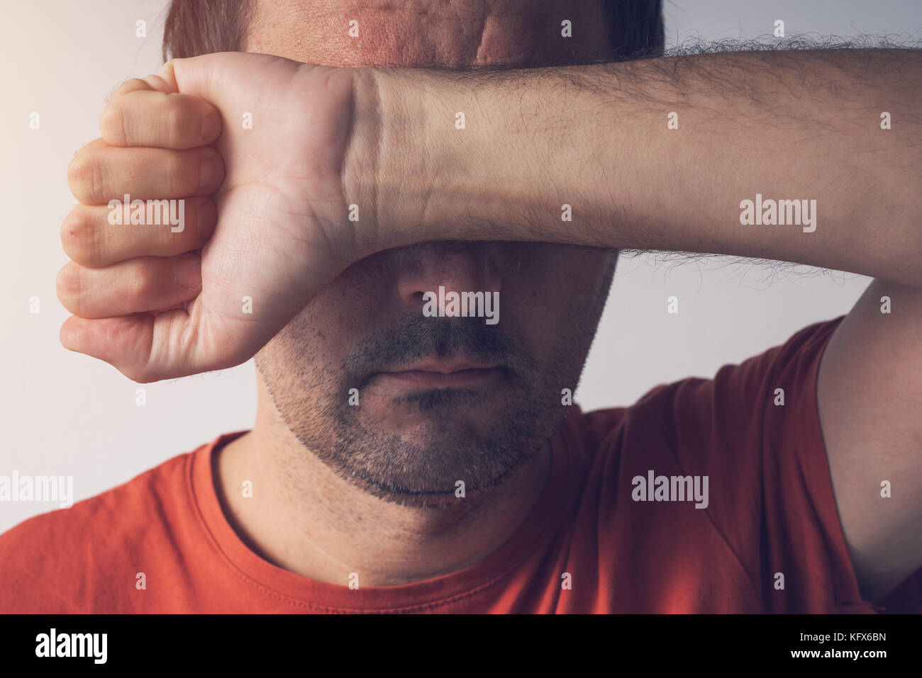 Shame and guilt, man covering face. Ashamed disgraced and embarrassed person. - Stock Image