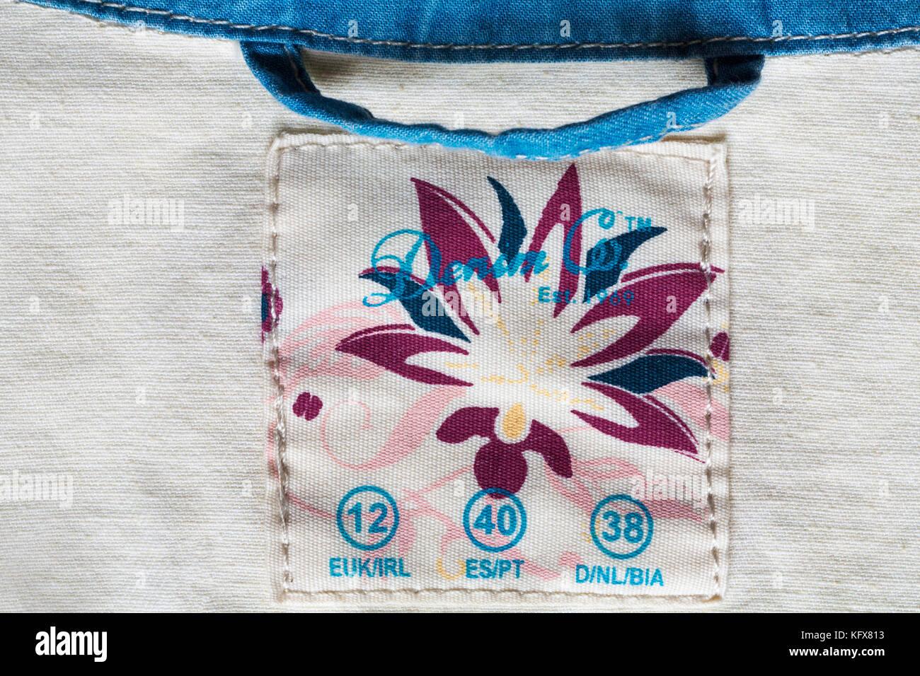 Denim & Co label in woman's denim shirt - Stock Image
