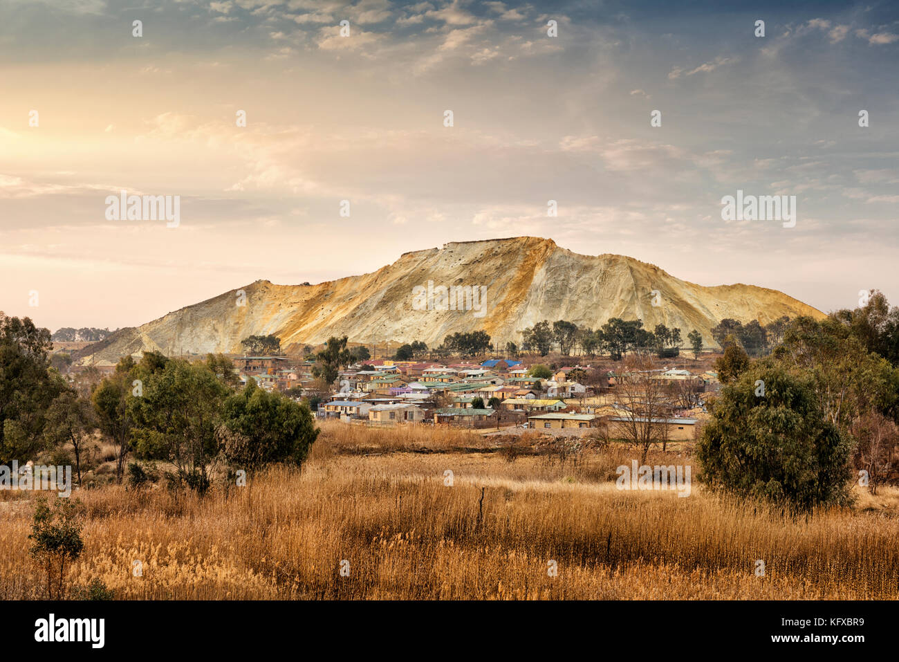 Shacks built in a mine dump from a distance, Johannesburg - Stock Image