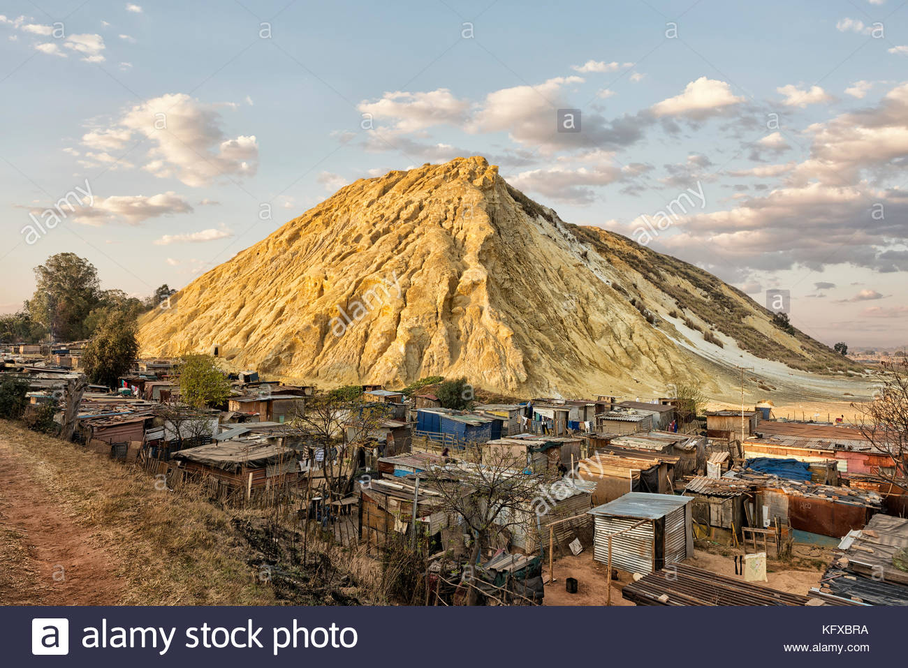 Shacks built in a mine dump, Johannesburg - Stock Image
