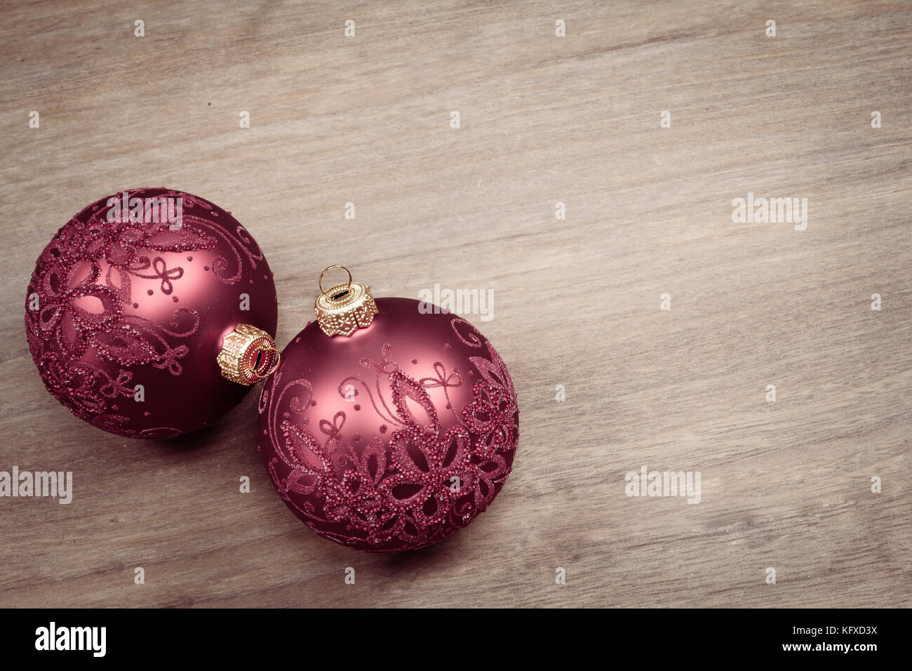 Christmas balls isolated on wood tabletop background.. Decorated glass baubles. Vintage tone. - Stock Image