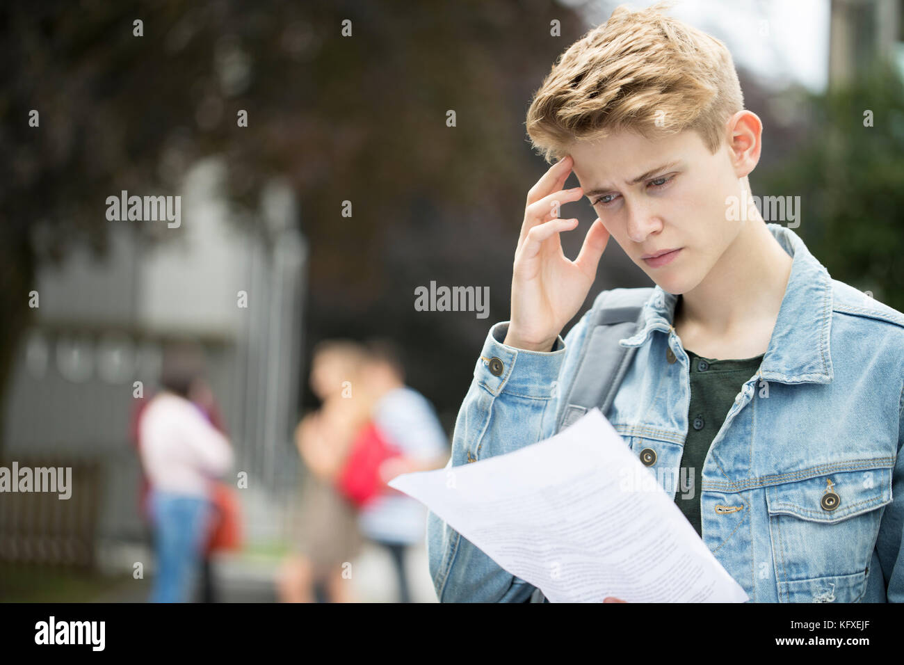 Teenage Boy Disappointed With Exam Results - Stock Image