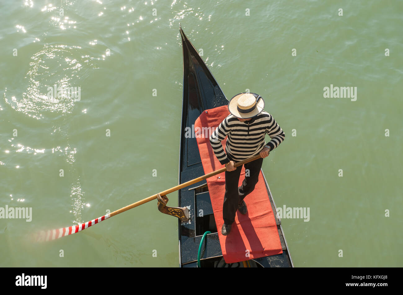 Gondolier in Grand Canal, Venice, Italy - Stock Image