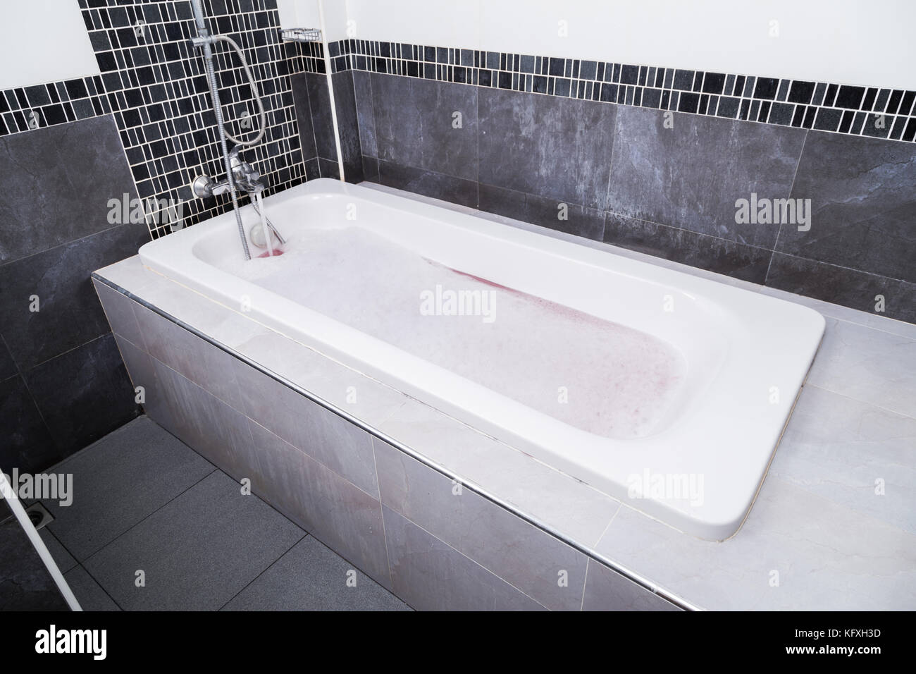 white modern bathtub with bubble bath in the bathroom Stock Photo ...
