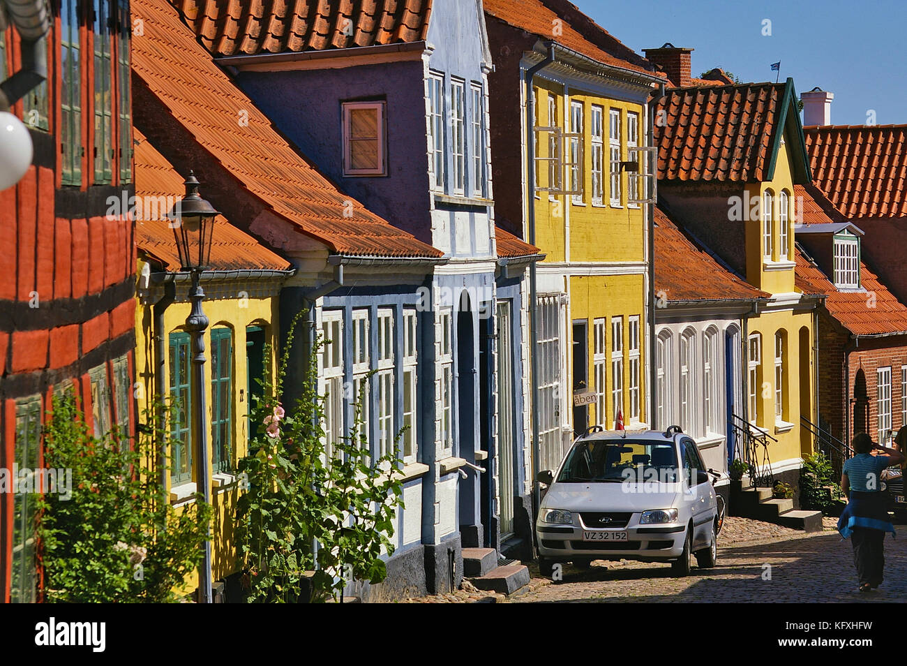 Aeroskobing, Denmark - July 4th, 2012 - Narrow cobblestone street on the island of Aero with colorful historic residential - Stock Image