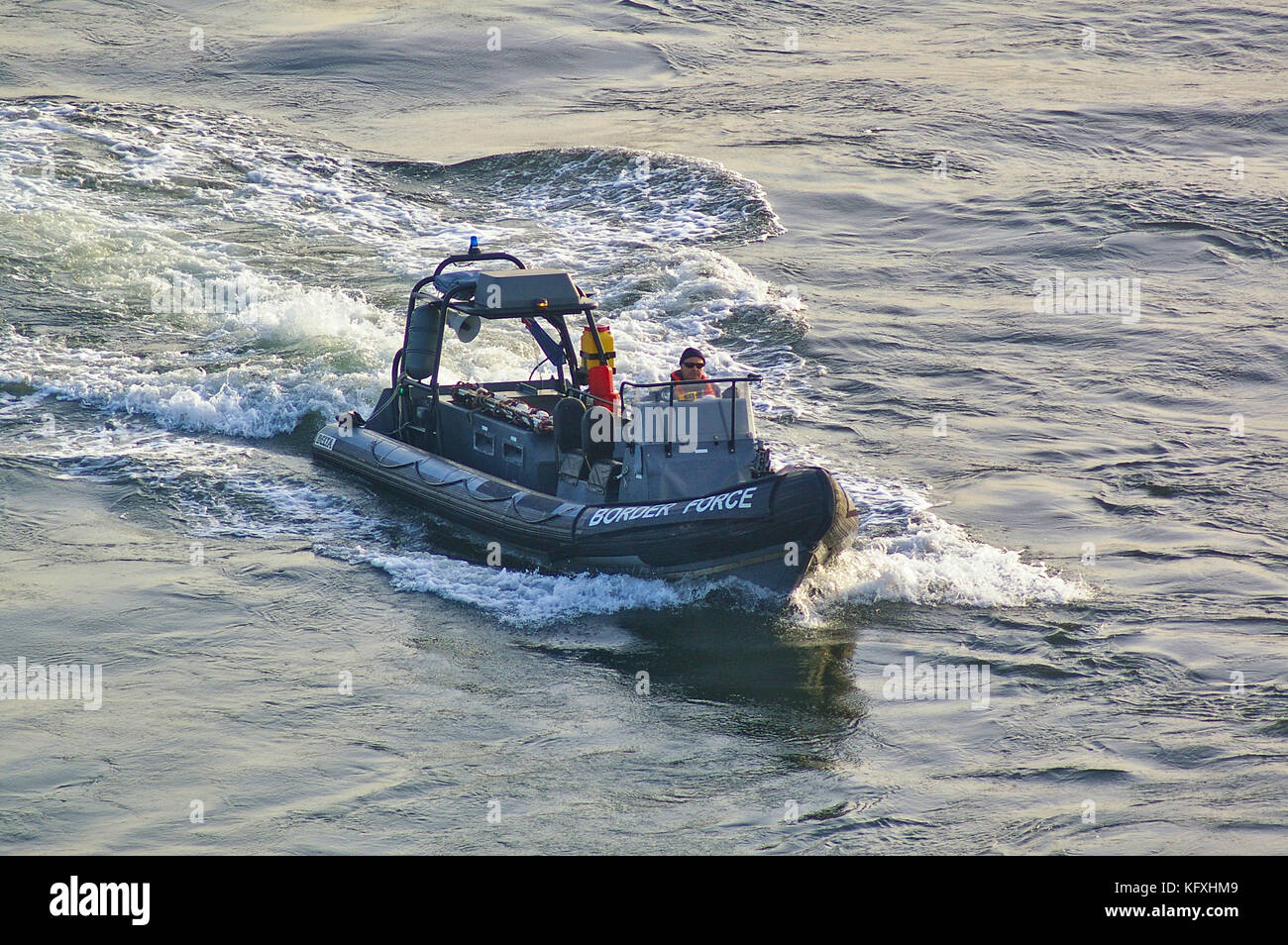 Newcastle, United Kingdom - October 5th, 2014 - UK border force RIB patrol boat with crew member - Stock Image