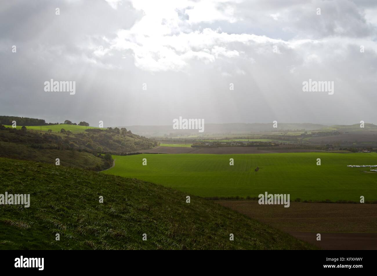 Sun breaking through the clouds on a windy October day on Dunstable Downs, view of fields, Bedfordshire, UK Stock Photo