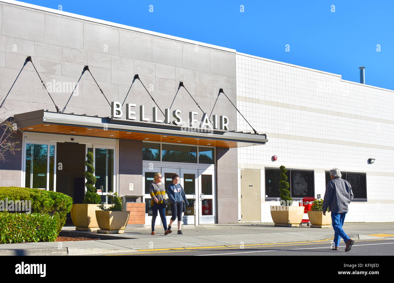 Bellis Fair mall in Bellingham, Washington with shoppers coming out of the mall and going into the mall.  A target - Stock Image