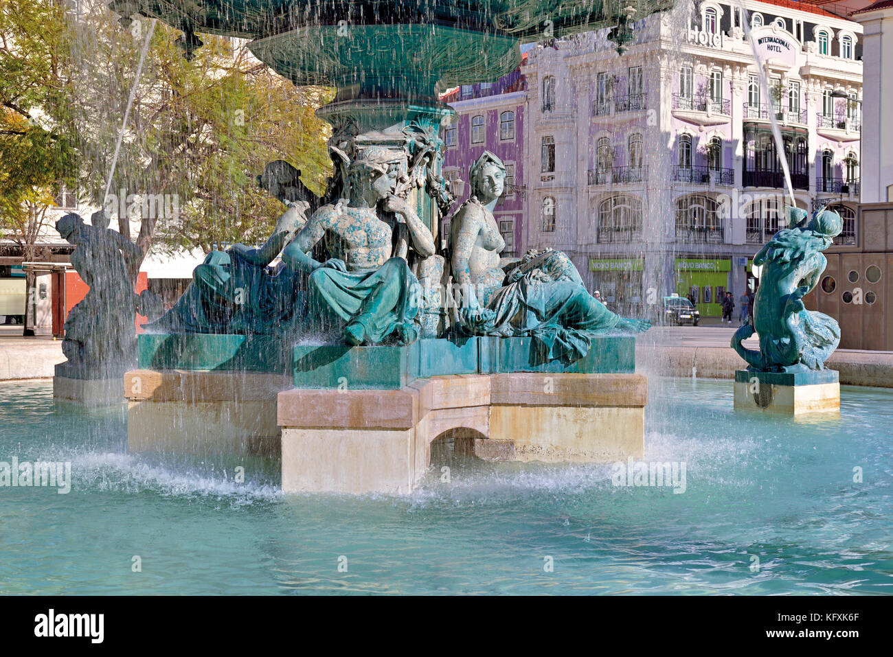 Bronze fountain with mytholoical figures in downtown Lisbon - Stock Image