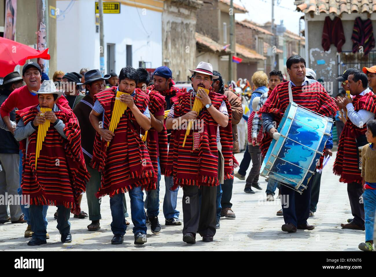 Music group in Ponchos with Siku, Panflute, Festividad Virgen del Rosario, Tarabuco, Chuquisaca, Bolivia - Stock Image