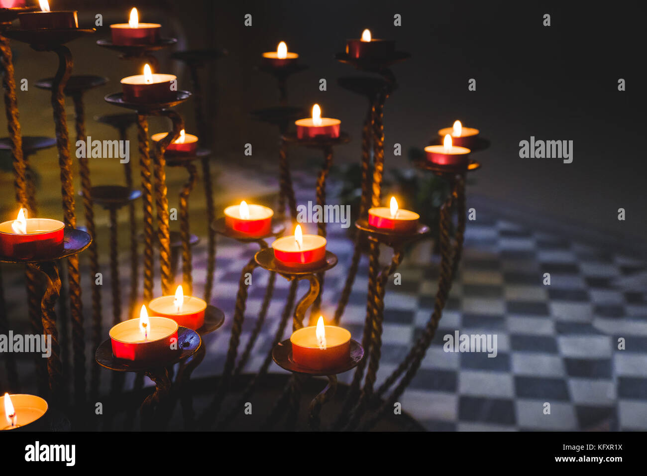 little candles candlestick dark background - Stock Image
