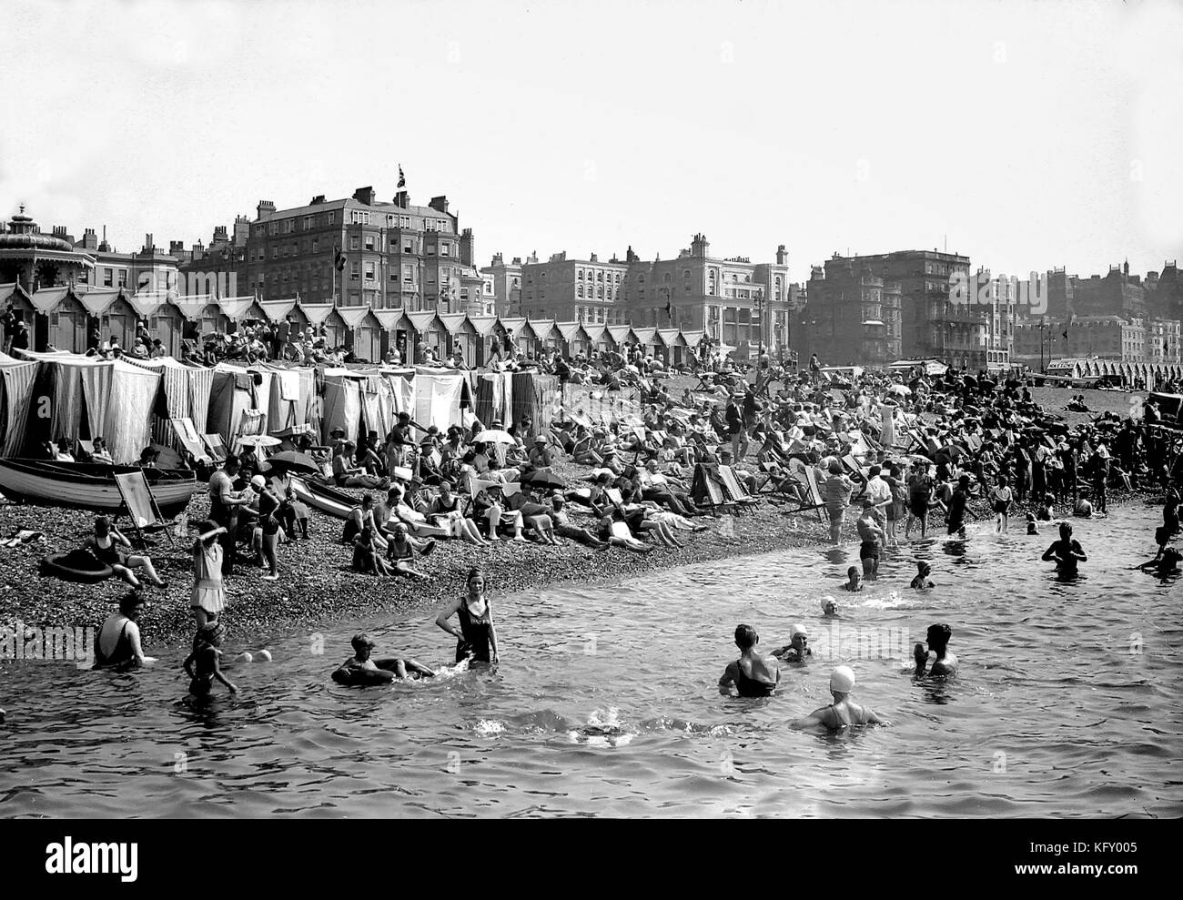 Vintage black and white image of Holidaymakers on Brighton Beach circa 1920 Stock Photo