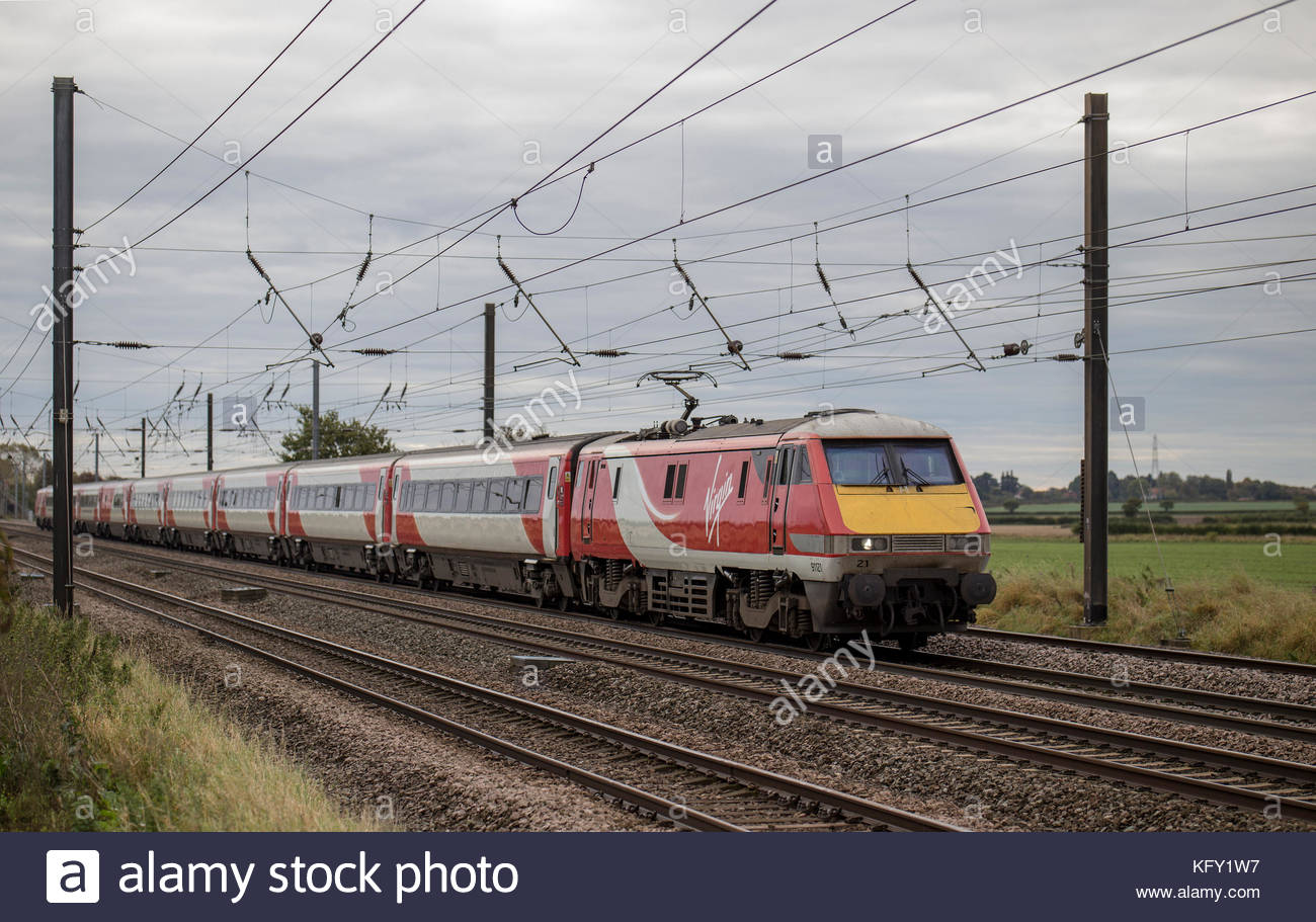 Virgin Trains East Coast Class 91 heading towards Edinburgh, from London Kings Cross - shown just north of York. - Stock Image