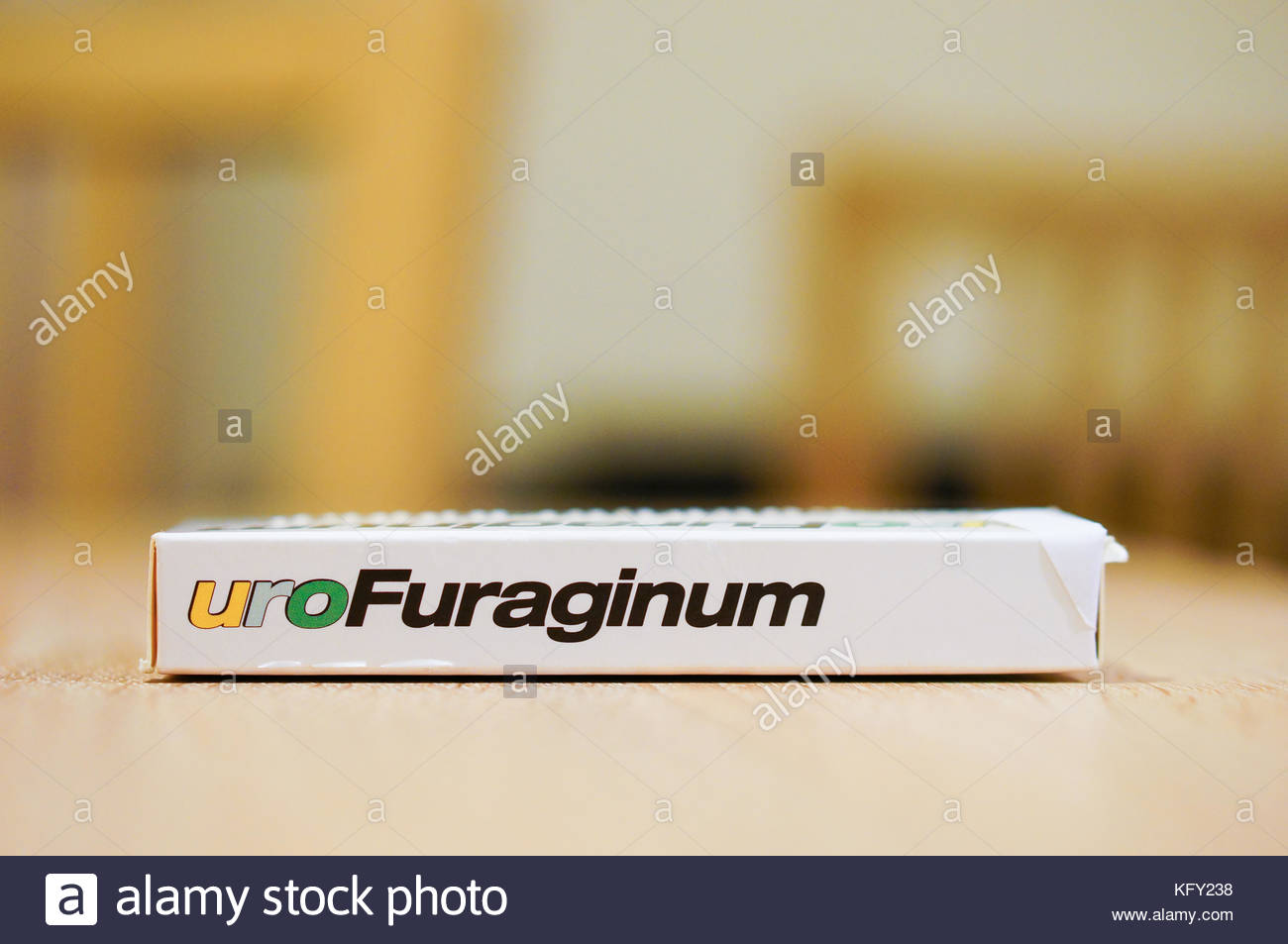 POZNAN, POLAND - DECEMBER 16, 2015: Uro Furaginum medicine in a box on wooden table - Stock Image