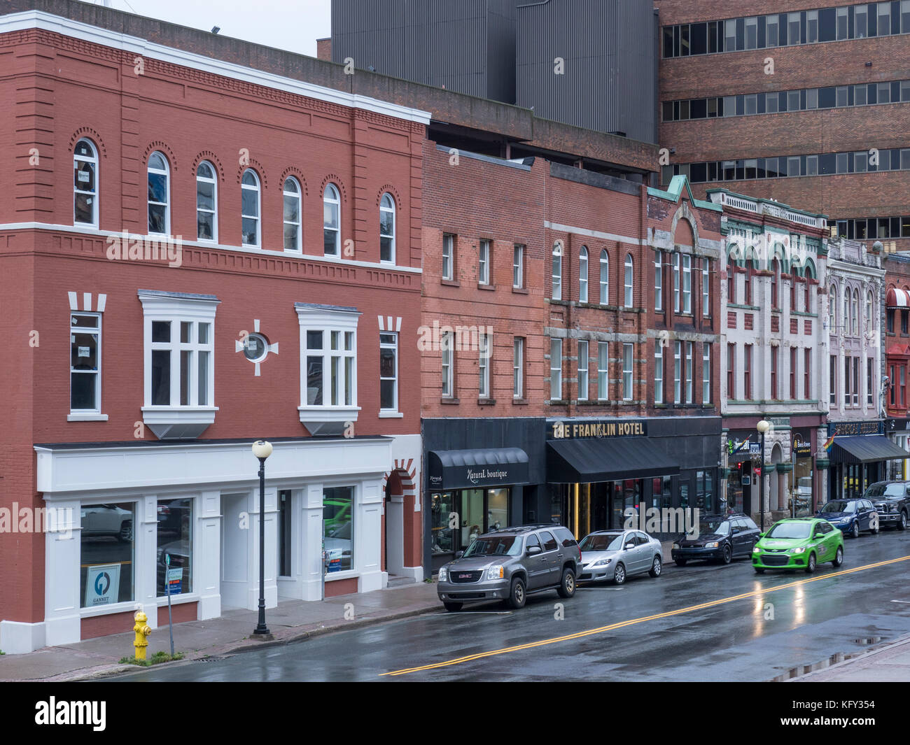 The Franklin Hotel and other shops and restaurants on Water Street, Saint John's, Newfoundland, Canada. - Stock Image