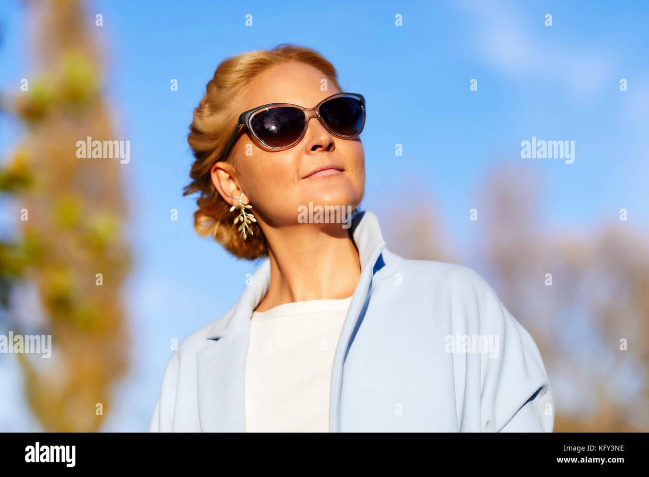 Beautiful woman wearing sunglasses - Stock Image
