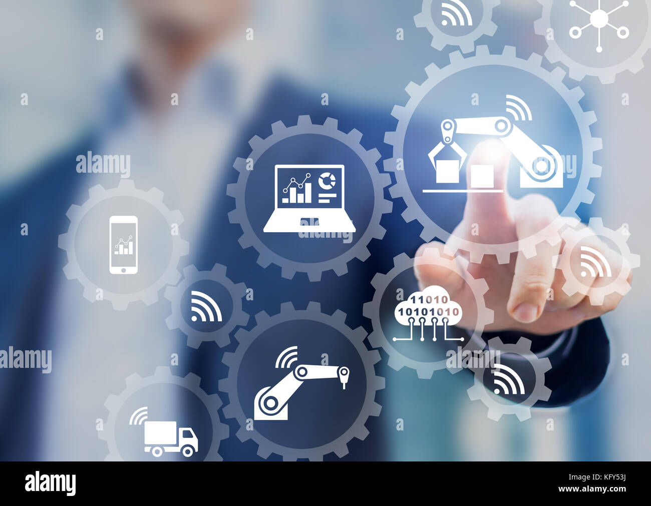 Smart factory and industry 4.0 concept with connected production robots exchanging data with internet of things - Stock Image