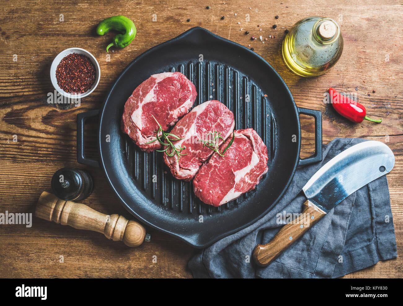 Ingredients for cooking Rib eye roast beef steak in pan - Stock Image