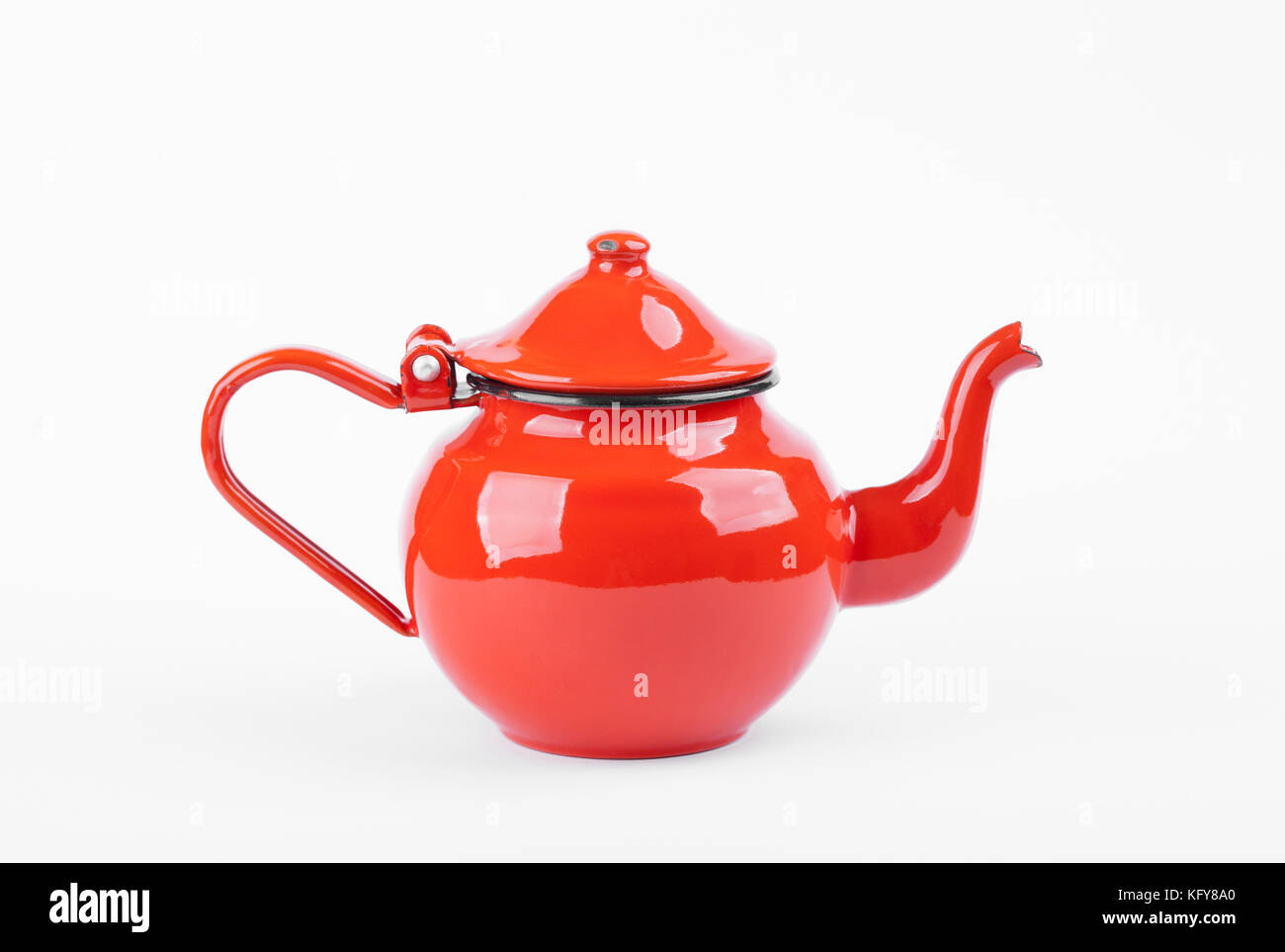 Red tea kettle isolated on white - Stock Image