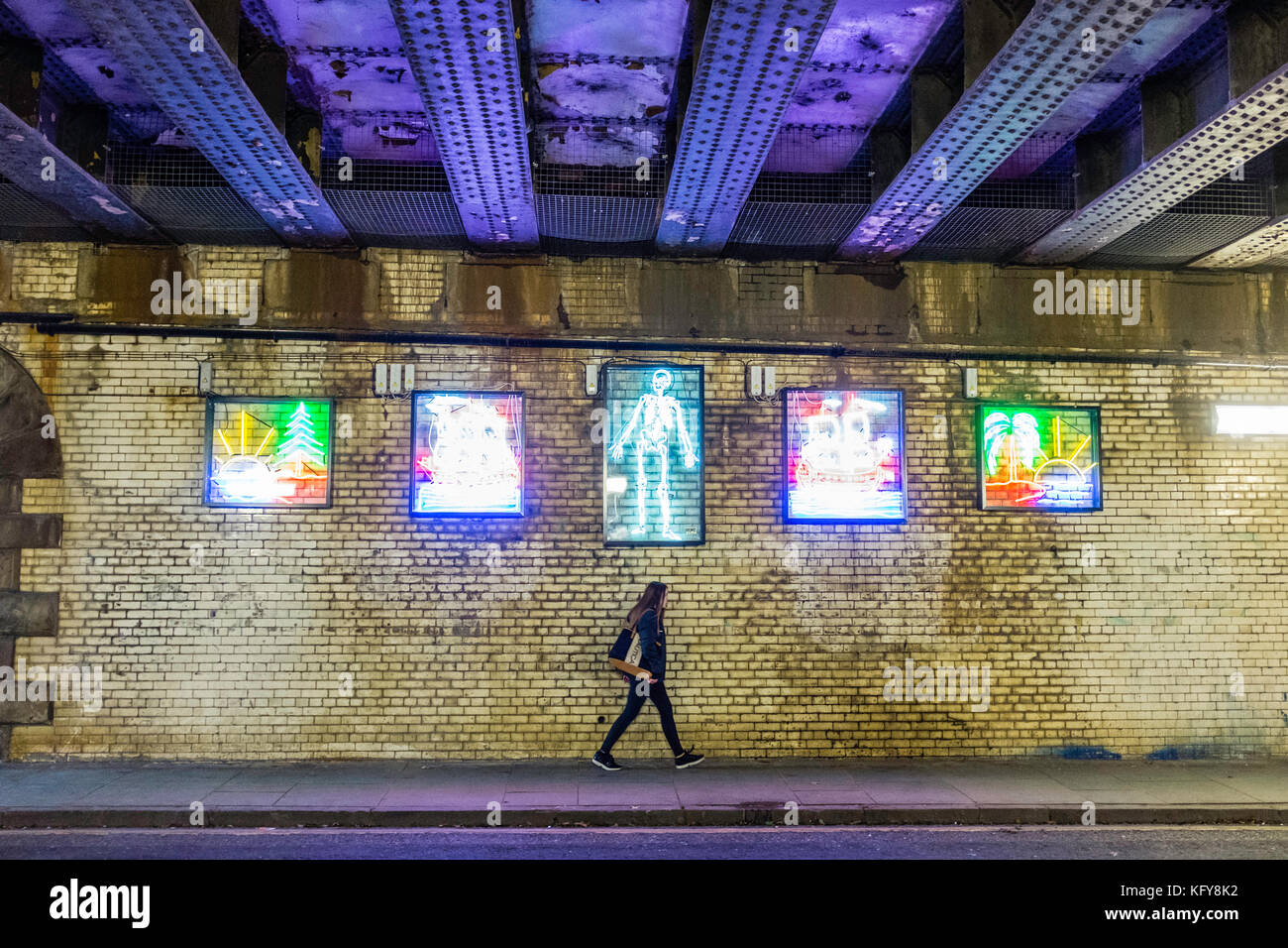 Street art made from colourful neon lights on underpass in central Edinburgh, Scotland, United Kingdom - Stock Image