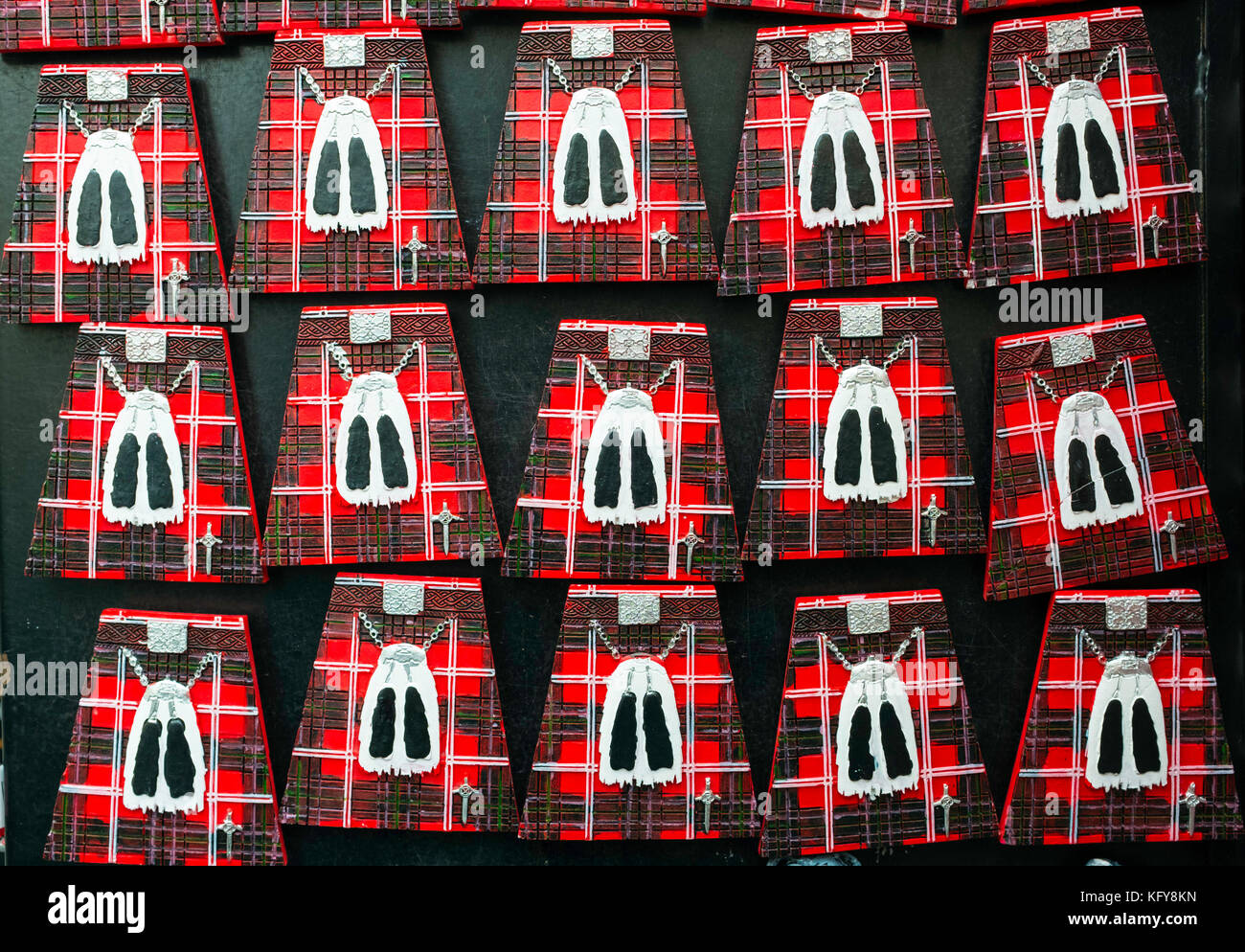 Geometric view of fridge magnets in shape of Scottish kilts for sale in tourist gift shop on the Royal Mile in Edinburgh, Stock Photo