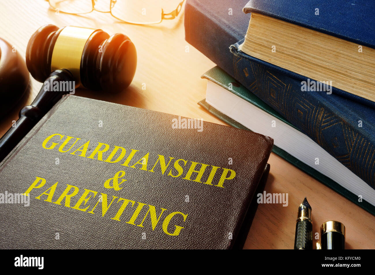 Book about Guardianship & Parenting on a table. - Stock Image