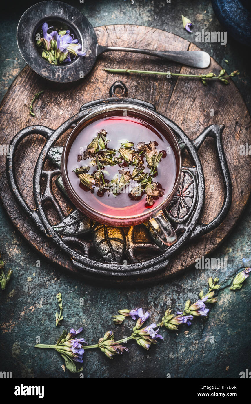 Healthy herbal tea concept , cup of tea with fresh herbs and flowers on rustic vintage background, top view Stock Photo