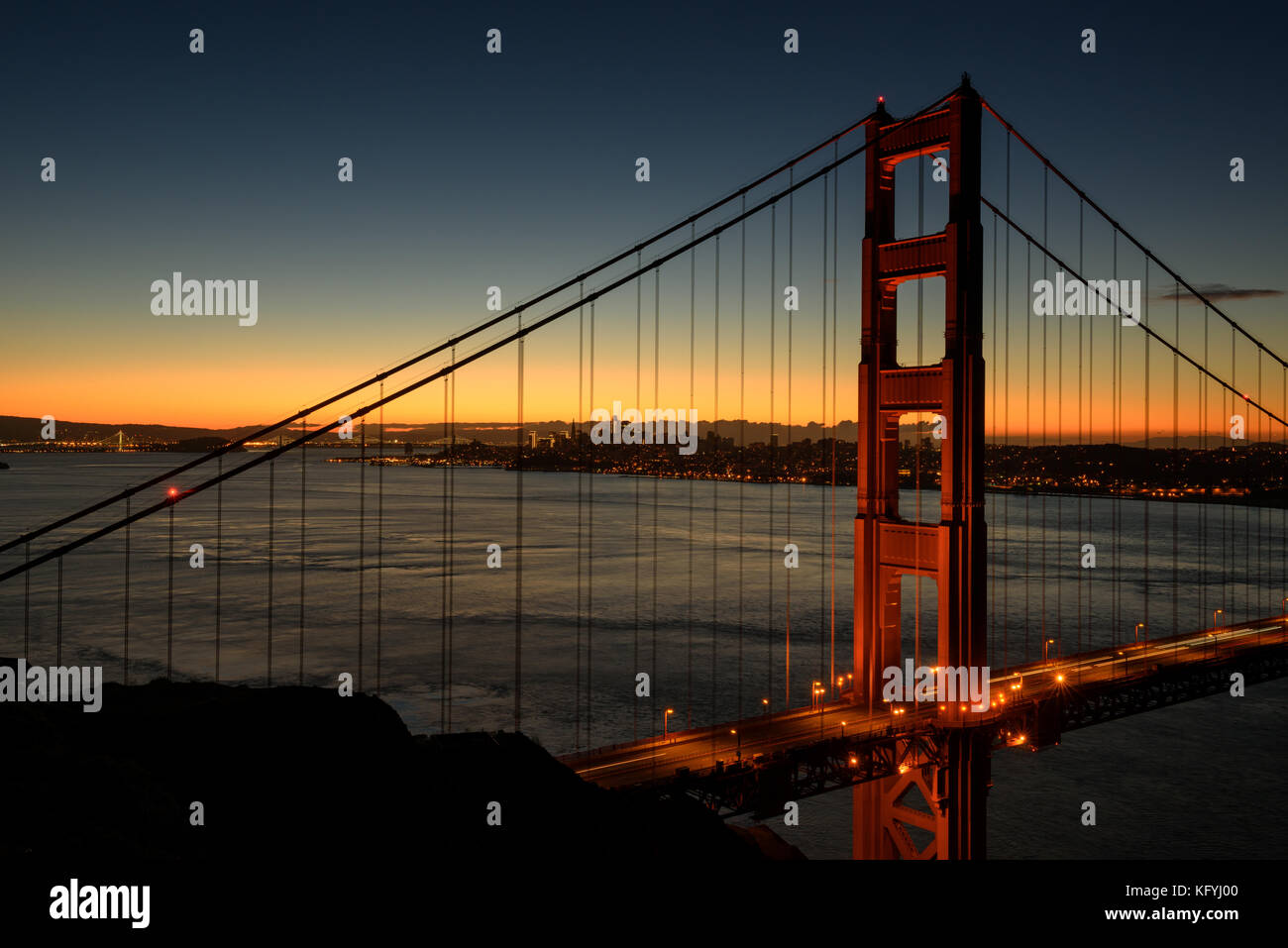 Beautiful Golden Gate the entrance to San Francisco, California, USA. Sunrise scene and down town as a background. - Stock Image