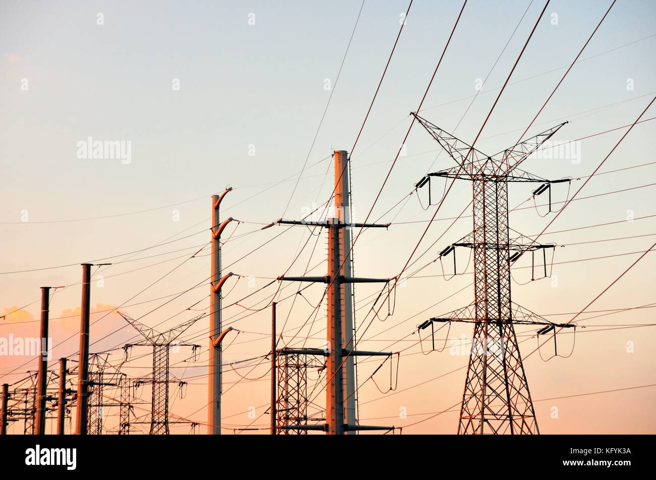 Power lines above a power substation in Elgin, Illinois. The power lines serve residential and commercial customers. - Stock Image