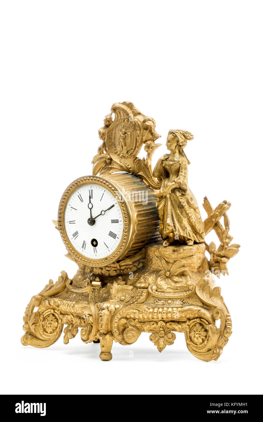 Antique golden table clock on the white background. - Stock Image