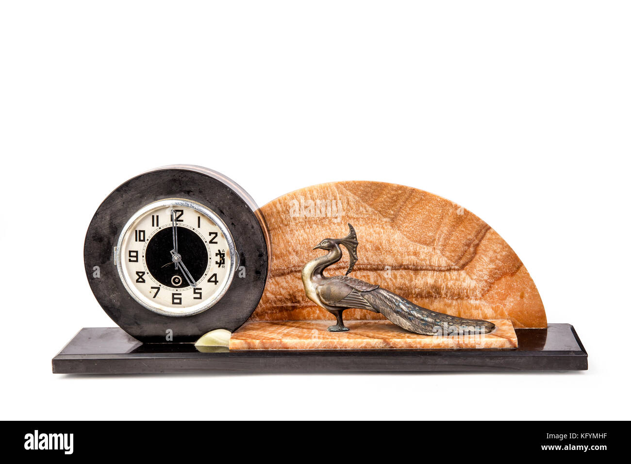 Antique table clock with peacock statuette on the white background. - Stock Image