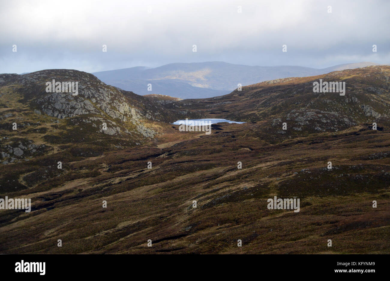 Lochan Na Mna from Beinn Domhnuill on route to the Scottish Mountain Corbett Meall na Fearna in Perthshire, Scottish - Stock Image