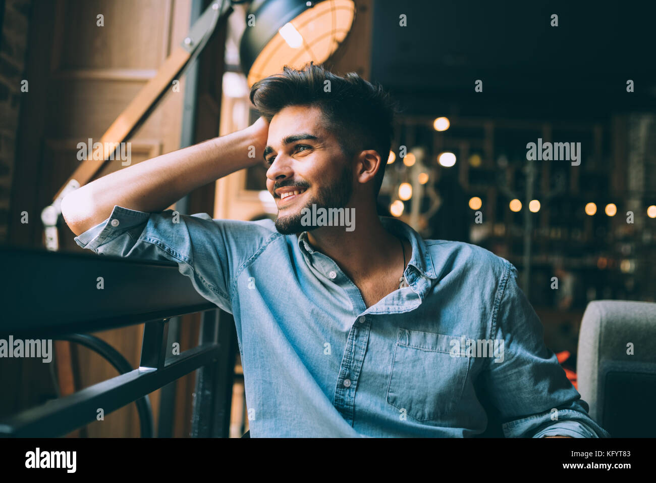 Portrait of young handsome man in blue shirt - Stock Image