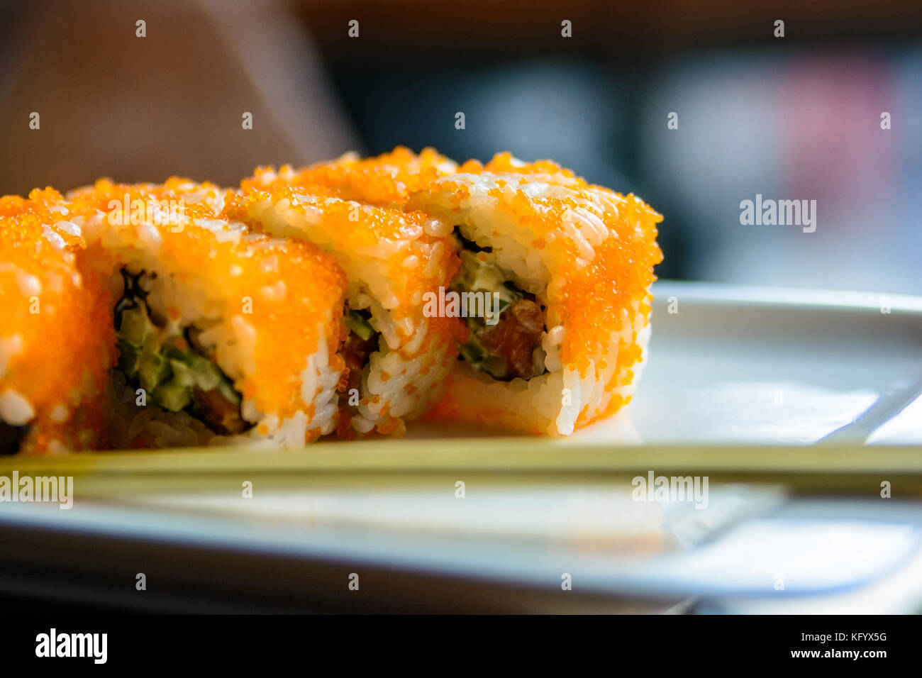 Close up tasty Japanese rolls on plate - Stock Image