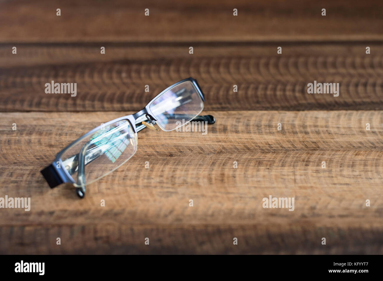 spectacle on a wooden background. spectacles with reflection of a window. image with copy space (selective focus) - Stock Image