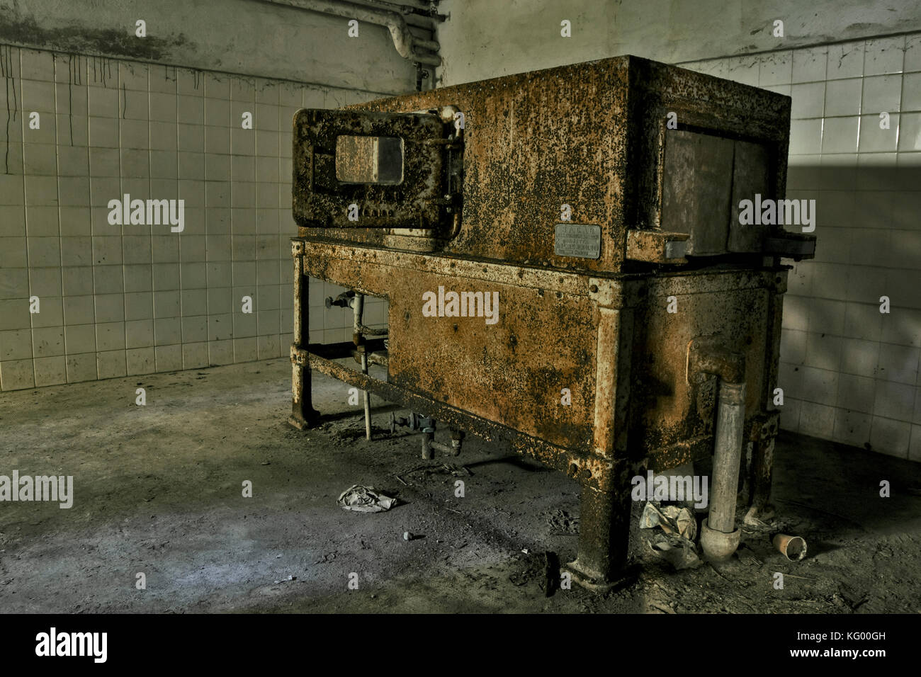 an old and rusty machinery in a room of an abandoned psychiatric hospital - Stock Image