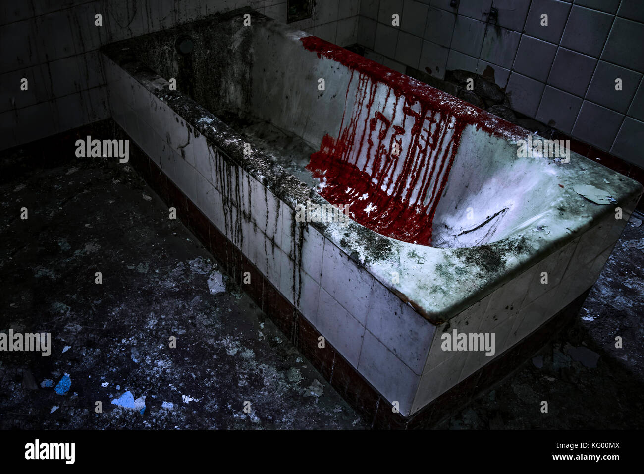 an old tub inside a psychiatric hospital, with a bloody spot - Stock Image
