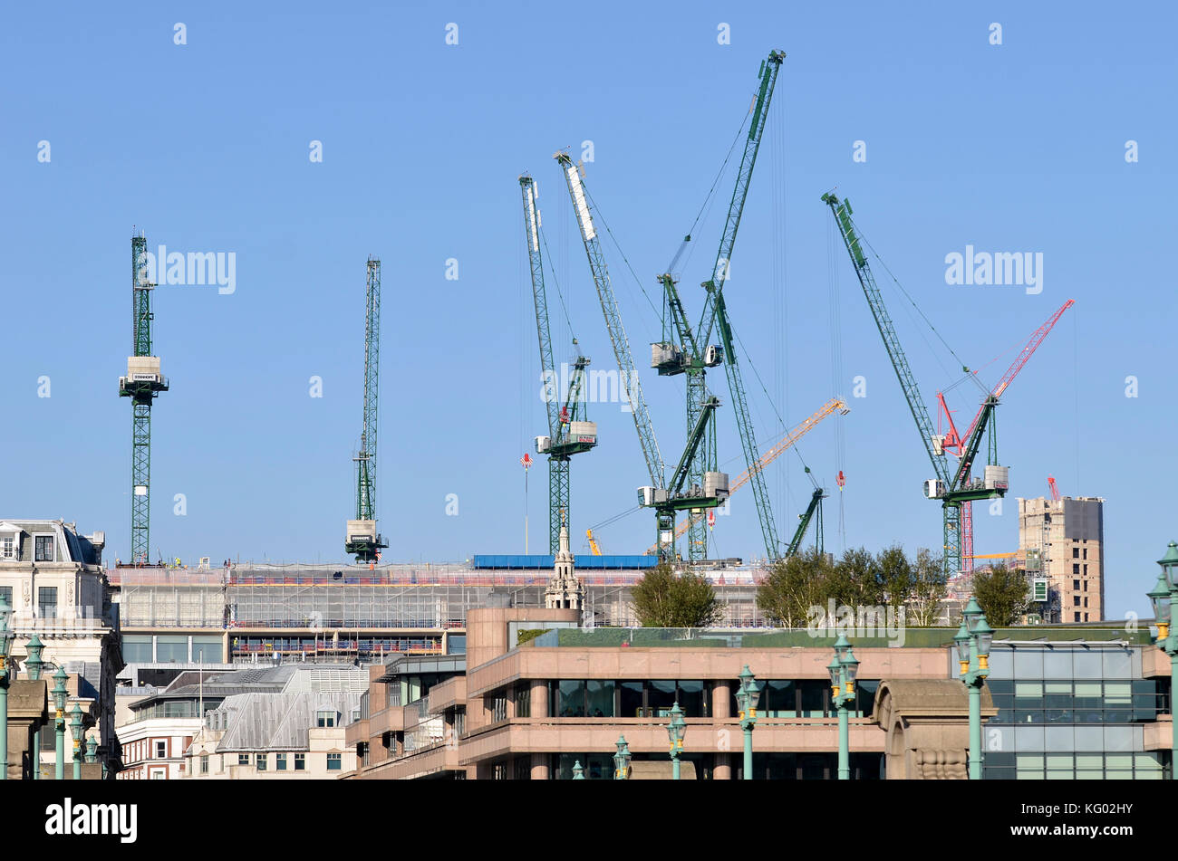 Cranes, London, UK. Tower cranes seen on the Bloomberg Place development site. - Stock Image
