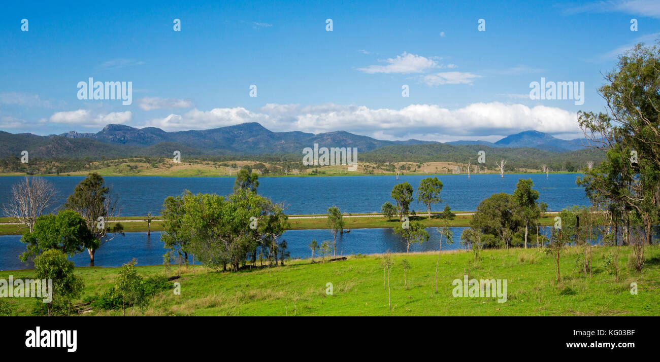Spectacular panoramic view of Lake Awoonga  with vast blue waters hemmed by forested peaks of Great Dividing Range - Stock Image