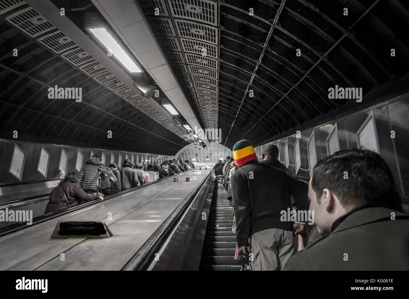People going upstairs on the escalator in the underground of Londen - Stock Image