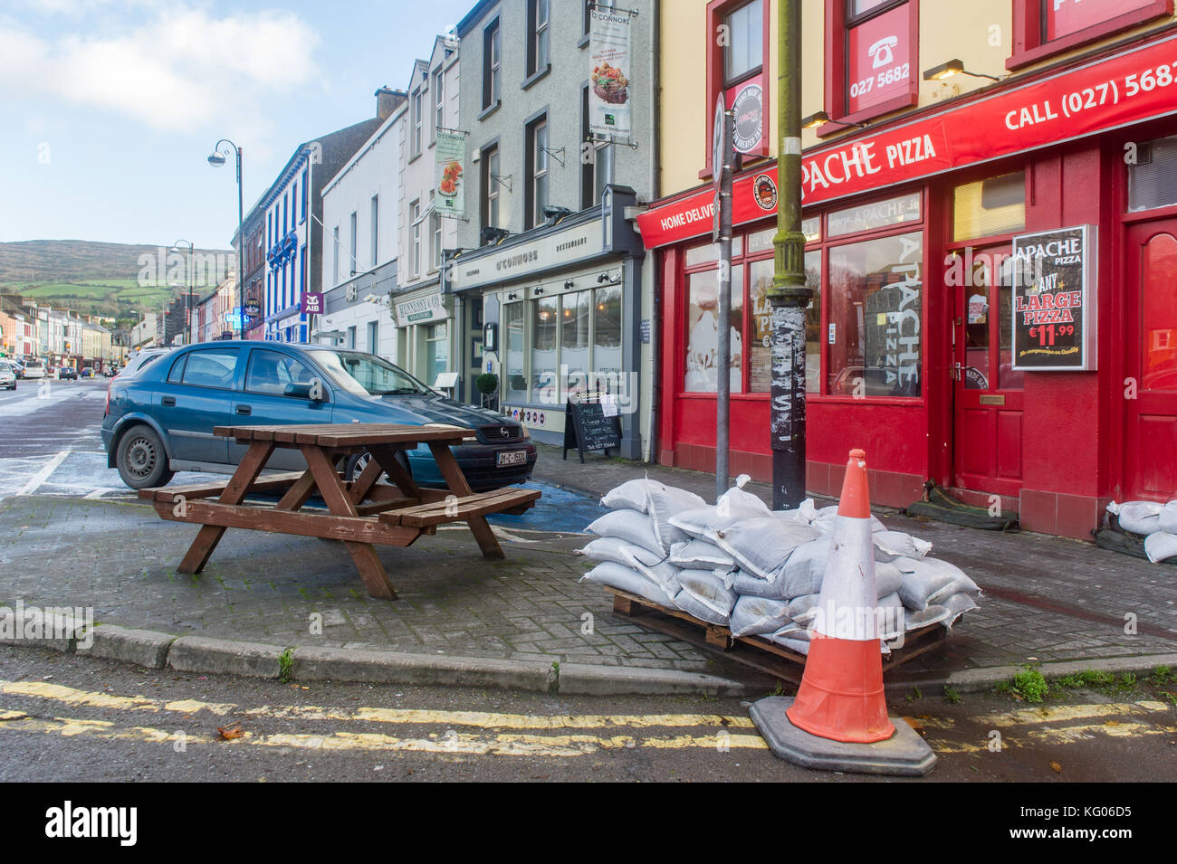 Sandbags on a pallet for shop owners to take in preparation for expected flooding in Bantry, West Cork, Ireland. - Stock Image