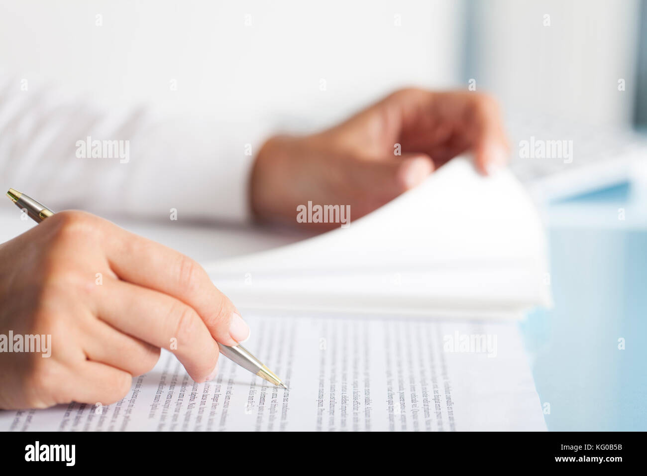 Close-up of a businesswoman's hand with a pen writing something. Stock Photo