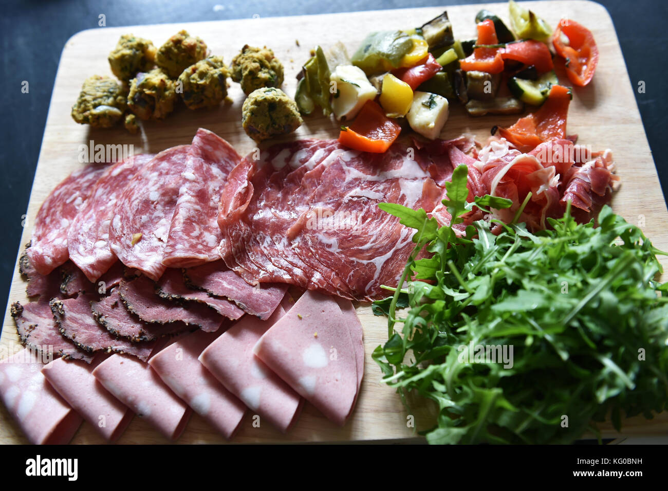 Sharing platter of cold meats and vegetables at a wedding - Stock Image