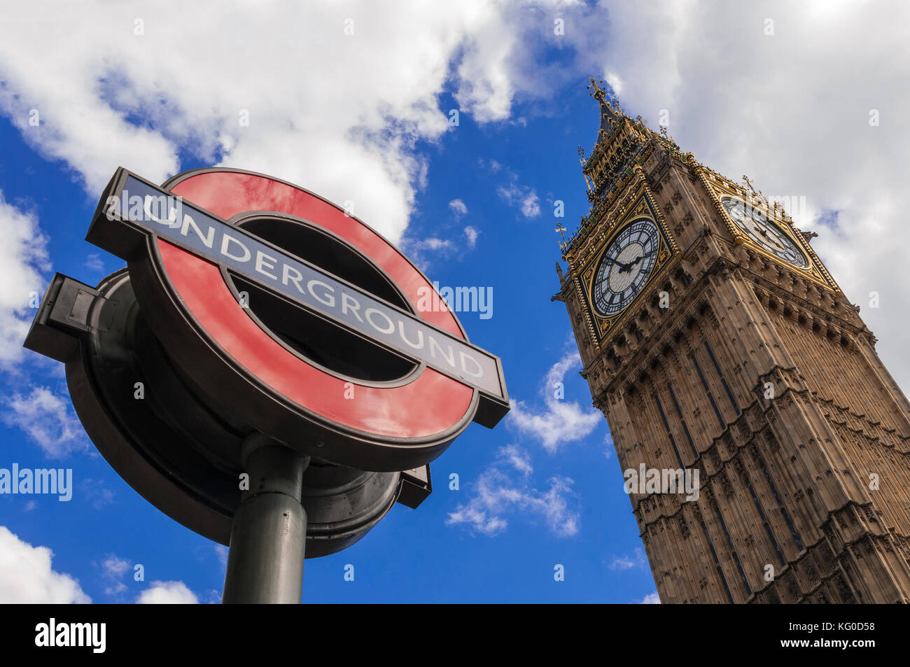 LONDON, UK - AUGUST, 11 2013; The sign of the London Underground and the Big Ben at the Westminster Tube station Stock Photo