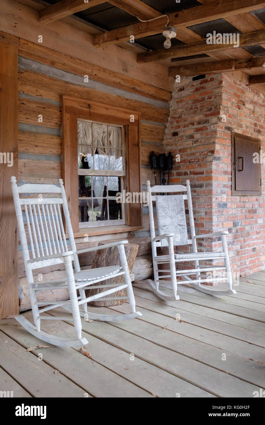 Enjoyable Old Fashioned White Rocking Chairs On The Front Porch Of An Creativecarmelina Interior Chair Design Creativecarmelinacom