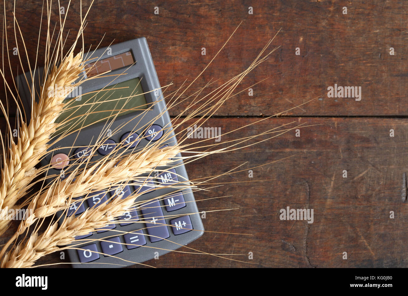 Cost of wheat stock photos cost of wheat stock images for Straw bale house cost calculator