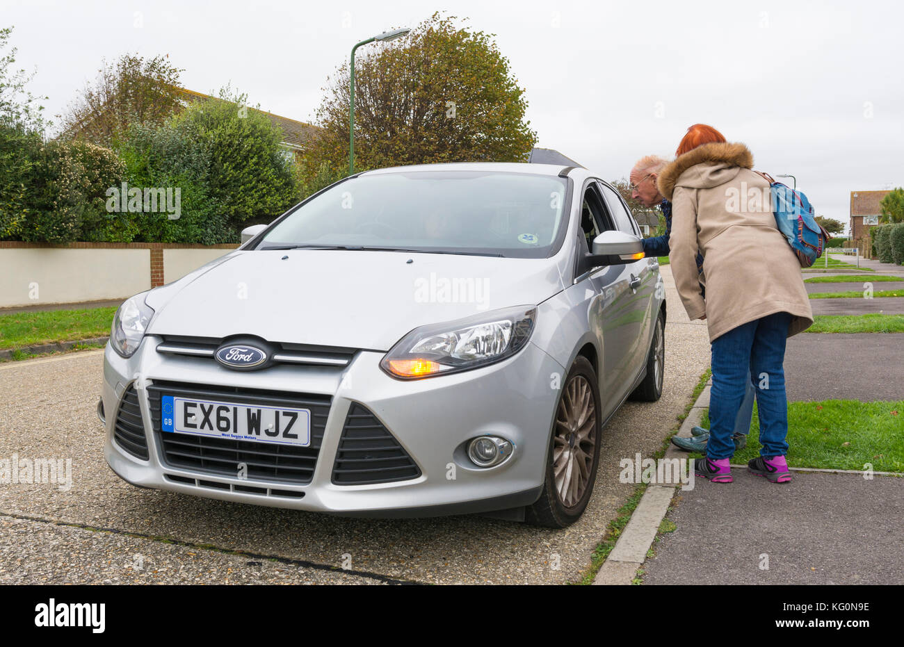 Car driver stopping to ask for directions in the UK. - Stock Image