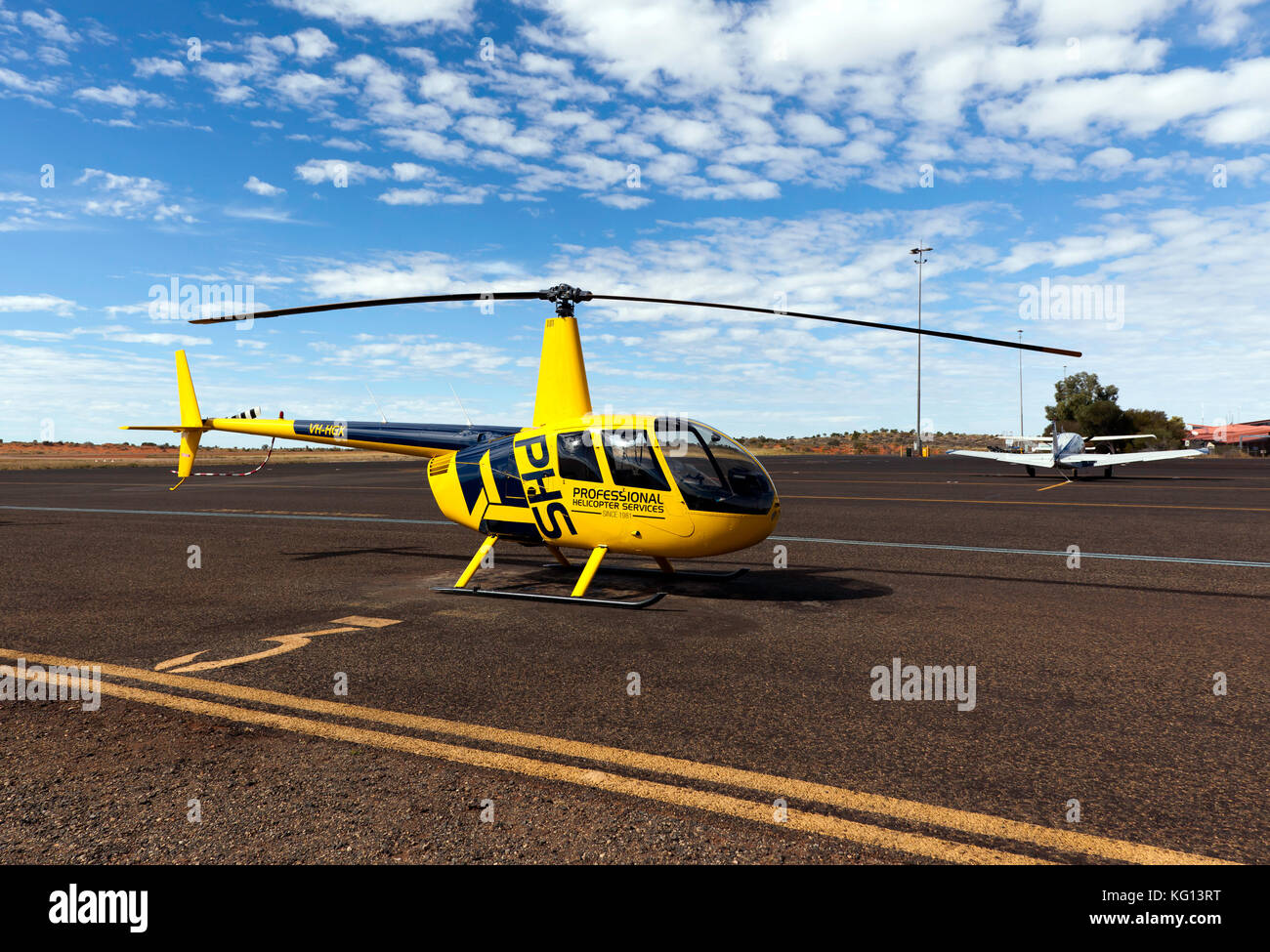 A Robinson R44 Raven operated by Professional Helicopter Services, based at Ayers Rock Airport, near Yulara, Northern - Stock Image